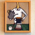 コーヒーをいれる女